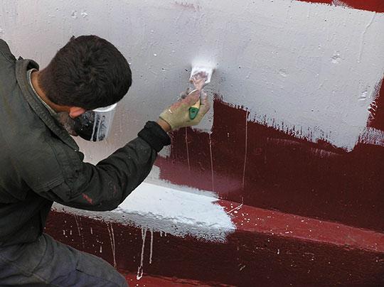 Устройство обмазочной гидроизоляции стен